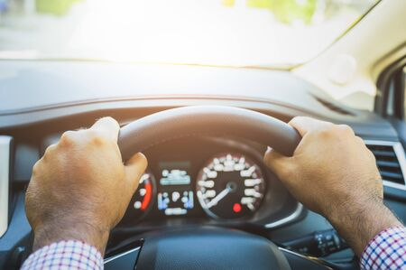 Close up front view hands hold steering wheel. Driving car concept. Stock Photo