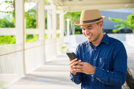 Young asian man using smartphone.