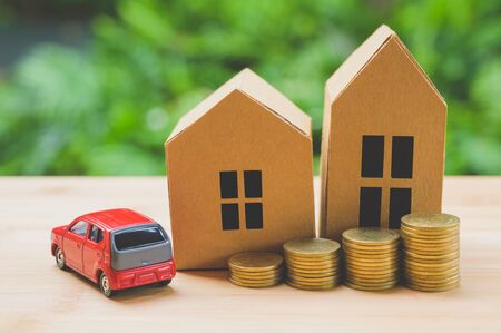 Saving money concept. Buy car, house, stack of coins.