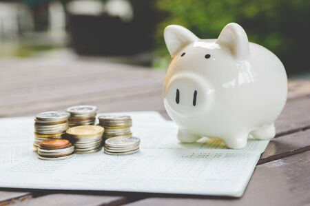 Piggy bank and stack of coin. Saving money concept.