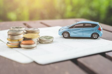 Car on stack of coin. Saving money for car concept. Car finance, buy car new concept.