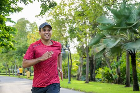 Healthy runner jogging outdoor. Fitness and sport healthy lifestyle concept.