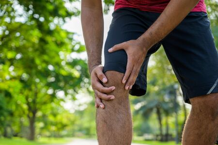 Close up Man having knee pain. Healthy running concept.