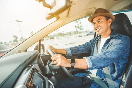 Asian men are driving carefully. And smile happily with this trip Stock Photo