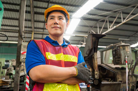 Asian Industrial workers are working on projects in large industrial plants with many devices.