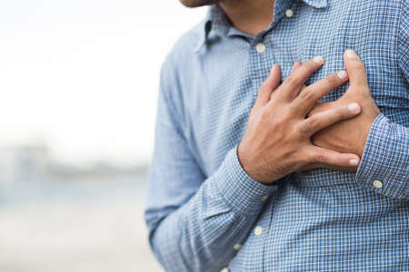 Hand man in the chest, squeezing his heart He had a sudden heart attack.