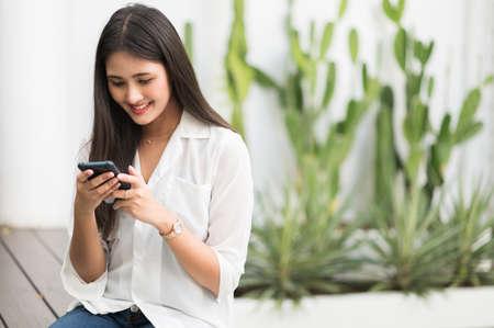 Young asian beautiful women using smartphone .