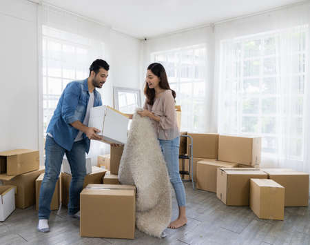 Husband and wife starting a new life just bought a house and moved in. Together they lifted many parcels, moved into the house and arranged.