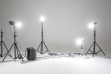 photo studio with lighting equipment fashion set as background photo