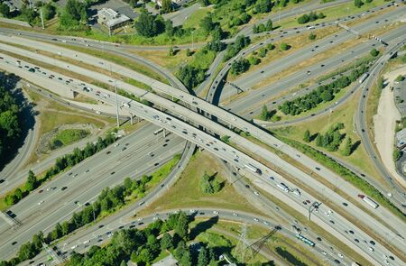 Aerial perspective of I-405 crossing over I-90 in Bellevue, WA