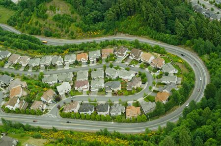 Aerial view of neighborhood on the bend of a windy hillside road