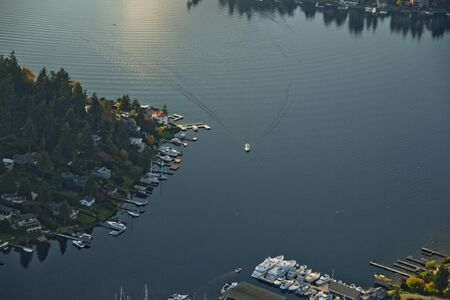 Aerial view of a small boat entering Meydenbauer Bay in Bellevue, WA
