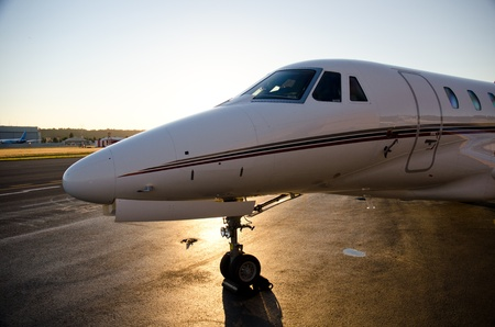 Citation X sits on the ramp at sunset.
