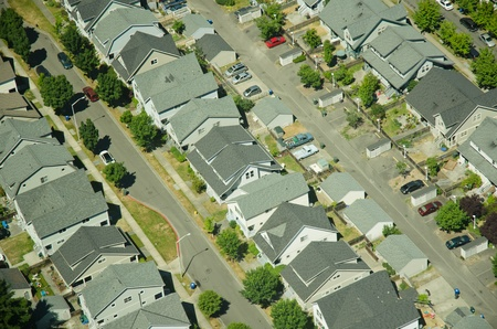 Three rows of houses in a new suburban housing development