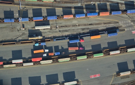 Overhead shot of different colored trucks and shipping containers