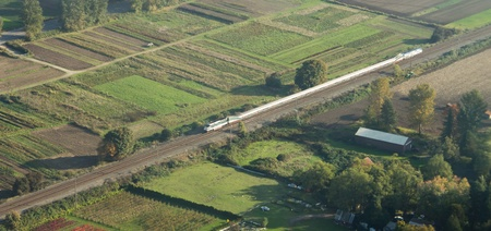Aerial view of an Amtrak train heading towards Seattle.