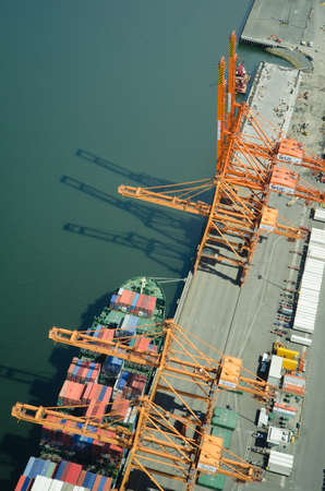 Aerial view of a docked ship being unloaded