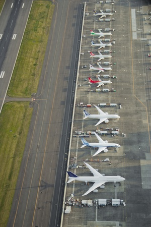 Aerial view of new 787, 747 and 737 airplanes awaiting flight test at sunset