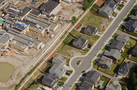 Aerial view of new retail development behind quiet suburban homes photo
