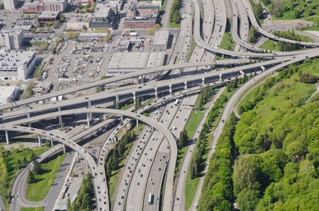 Aerial view of a complex interchange during rush hour photo