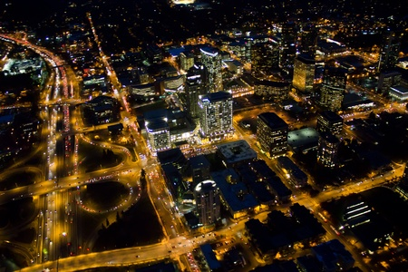 Aerial view of nighttime cityscape and lights