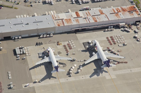 Aerial view of two FedEx airplanes loading and unloading at Seattle-Tacoma International Airport