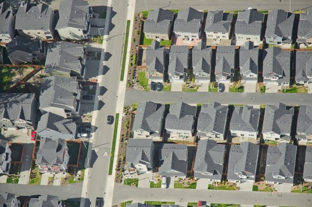 Aerial view of rows of houses and a commuter car heading to work photo