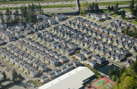 Aerial perspective of new, simple housing development