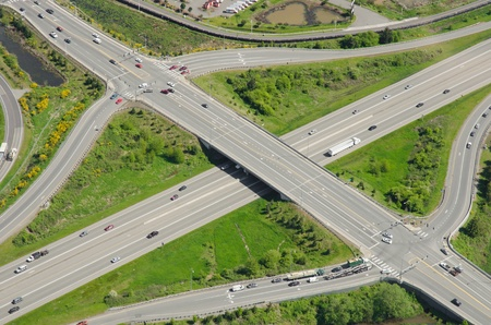 exits: Aerial view of typical highway exits and overpass
