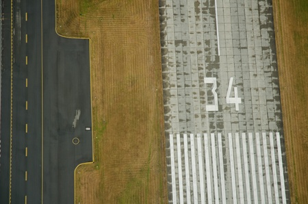 Aerial view of runway, taxiway, and grass photo
