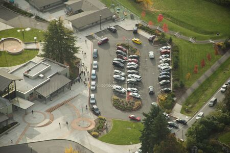 Cars in roundabout picking up students after school photo