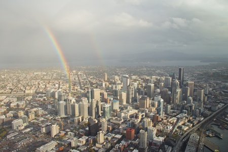 Two rainbows forming over downtown Seattle