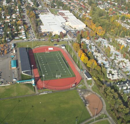 Aerial View of track and field at suburban public high school photo