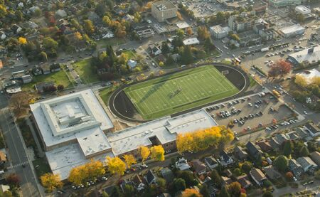 Aerial view of wealthy high school track, field and facility