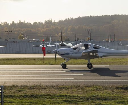 Small Diamond aircraft and wind sock at executive airport