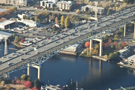 Aerial perspective of large bridge and reflections on canal