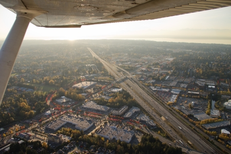 Aerial shot of sunset from pilot's perspective from a small airplane Standard-Bild