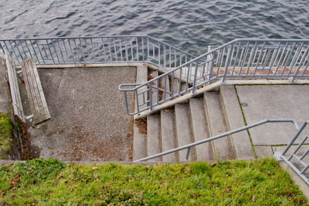 Staircase leading down to waterfront walkway