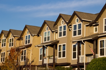 Three-story townhomes facing the setting sun Stock Photo