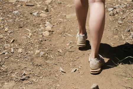 dirty feet: Empty space left close up of woman s feet hiking in dirt Stock Photo