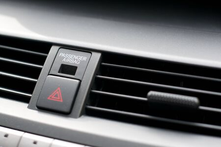 vents: Close up detail of warning lights button and air vents inside a car Stock Photo