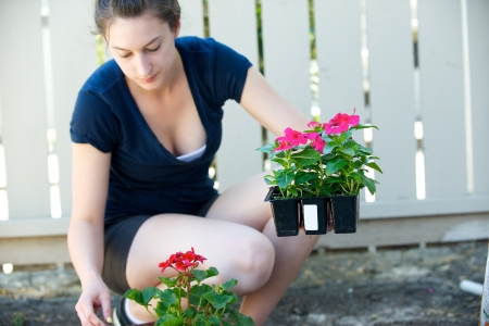 Young woman holds small crate of flowers photo