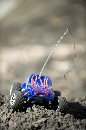 Veritcal of toy RC truck on dirt mound Stock Photo