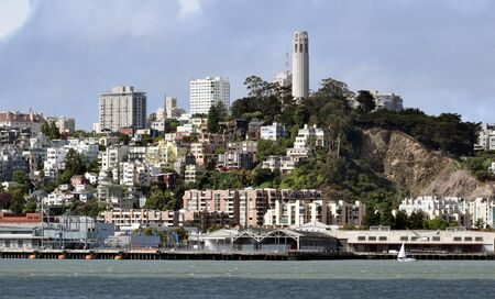 coit tower: Foggy San Francisco skyline during the day with Coit Tower Stock Photo