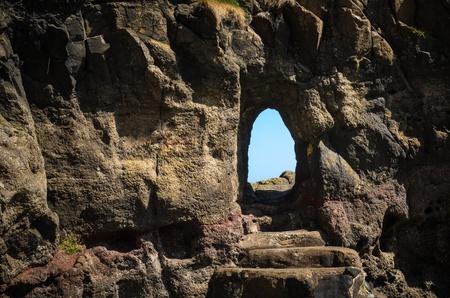 cleft: A crevice through rock