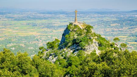 Felanitx, Mallorca, Spain – May 11 2011: The Cross of Santuario De San Salvador located in the Sanctuary de Sant Salvador: The cross stands 14m tall and is 509m above sea level on the highest point of the Serra de Llevant.