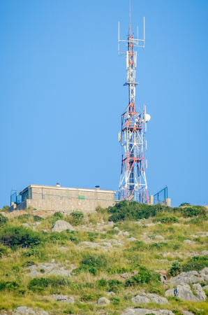 A heavily subscribed and congested radio base station is located in an elevated position for line of site communications links.