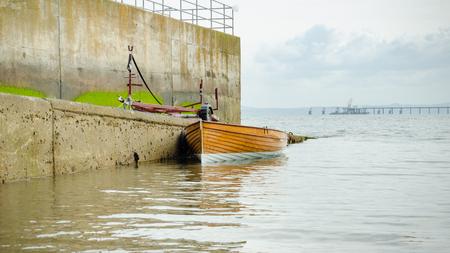 Dinghy moored alongside a slipway