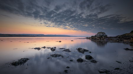 Dusk at low tide on Browns Bay, Islandmagee, County Antrim, Northern Ireland.