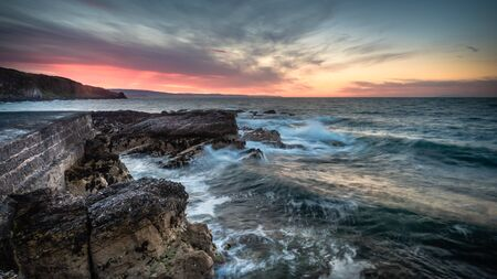 Portmuck, Islandmagee, County Antrim, Northern Ireland: A sunset scene from the seaward side of Portmuck harbour.
